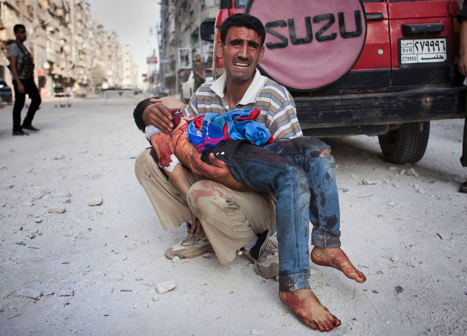 epa_syria_father_dead_child_50546784_ll_121005_18x13_1600